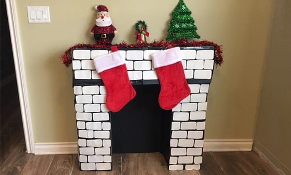 DIY chimney place with white bricks and stockings in living room