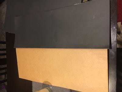 cardboard partially covered in black paper
