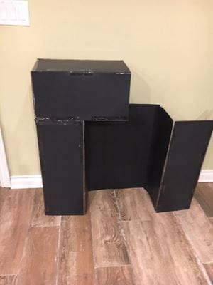 black cardboard box trifold with one black box on top