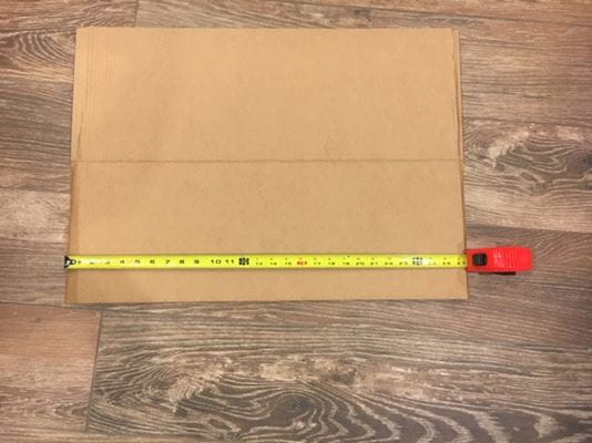 measuring cardboard with tape measure