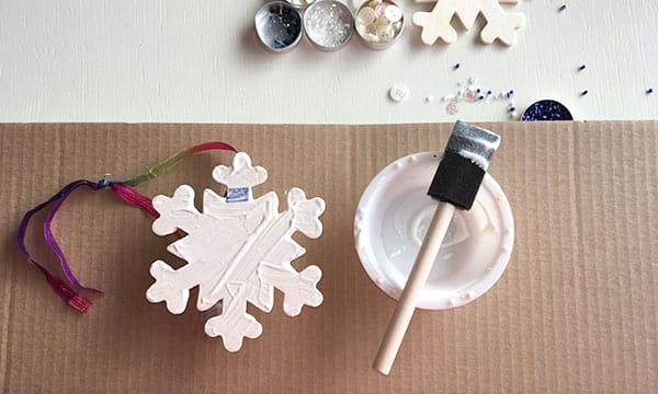 DIY snowflake christmas tree ornament project step one, apply glue