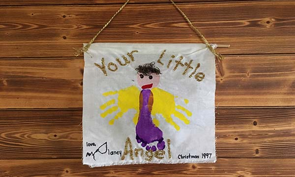 angel painted on cloth made with child's handprints and footprints