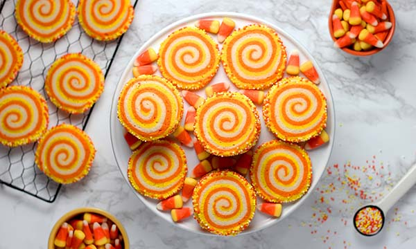 orange and yellow spiral cookies with candy corn