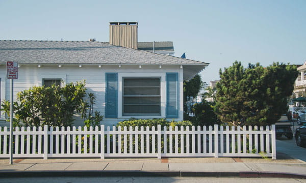 ranch house with white picket fence