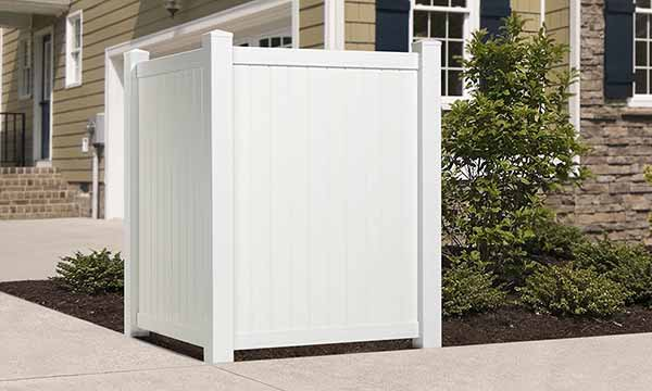 white vinyl corner privacy  fence outside house concealing air conditioning unit