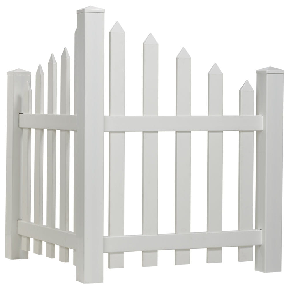 White vinyl scalloped spaced picket corner accent fence with spade shaped pointed pickets installed by driveway