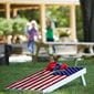 cornhole board with US flag decal, outdoors