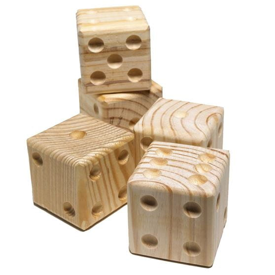 life-size wooden dice stacked