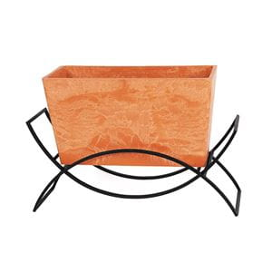 rectangular terra cotta planter in iron plant stand shaped like 2 interlocking half circles