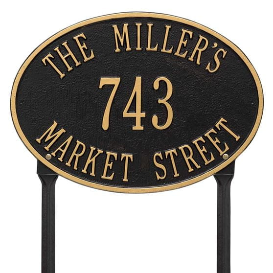 Oval lawn address plaque with house number and street, black with gold lettering and border