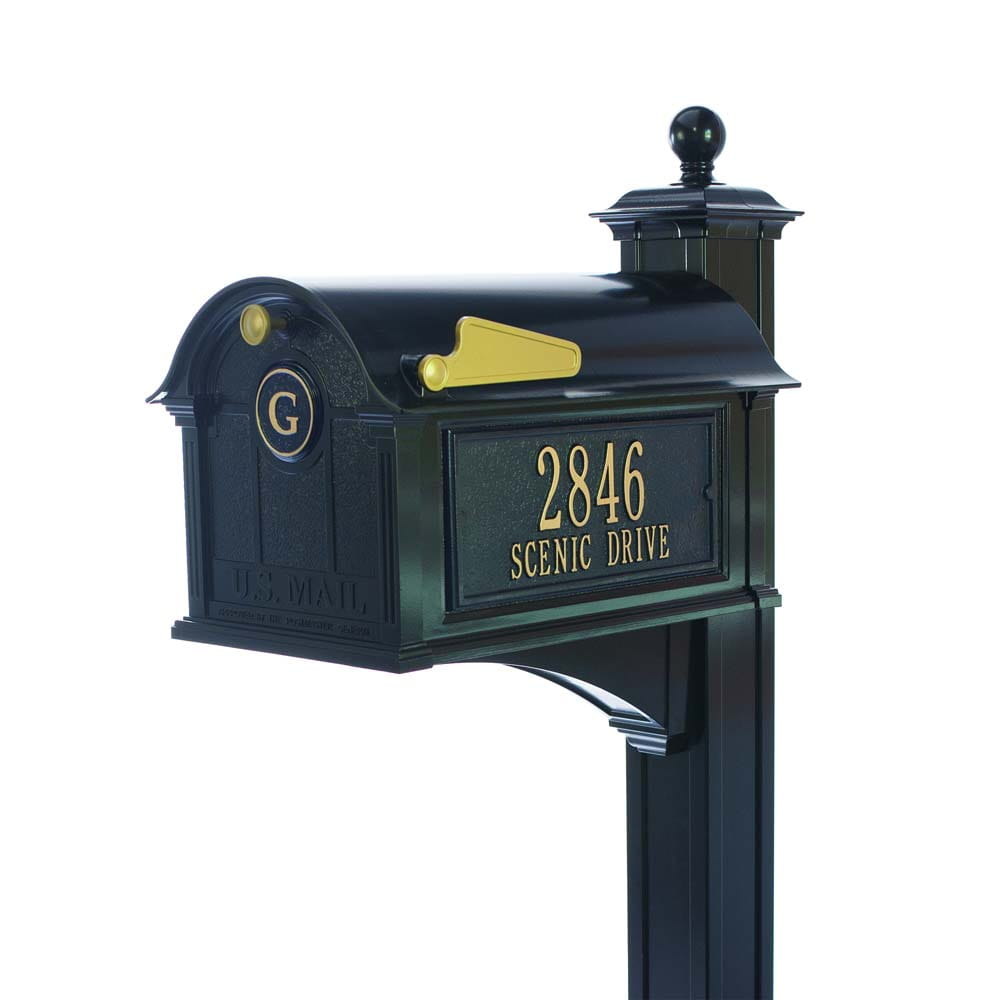 Black mailbox with address on side in gold lettering, with gold flag and handle