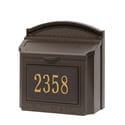 brown wall mailbox with gold house number on it