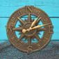Nautical french bronze clock on blue wood and fishing net