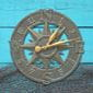 Nautical oil-rubbed bronze clock on blue wood and fishing net