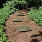 Outdoor Essentials green serpentine jade stepping stones on wood chip path