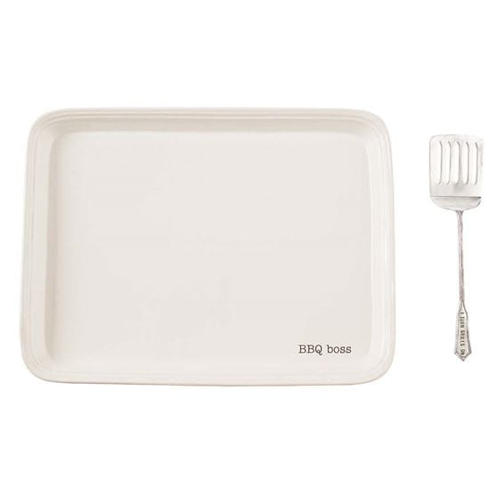 White platter with silver spatula.
