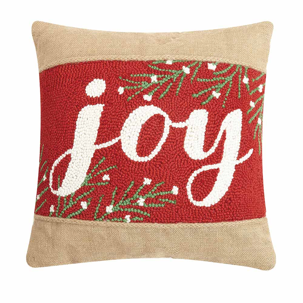 Red and tan square pillow with the word