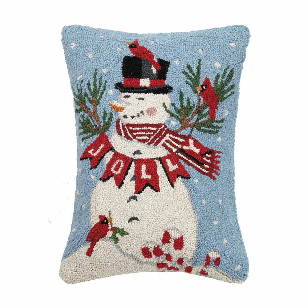 Rectangular pillow with snowman holding a banner reading