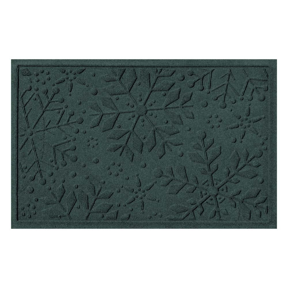 Green rectangular mat with snowflakes on it.