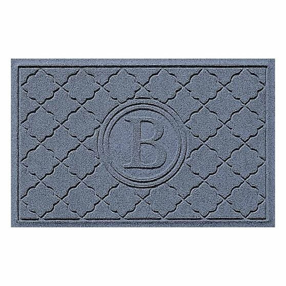 Blue rectangular mat with cordova pattern and giant letter