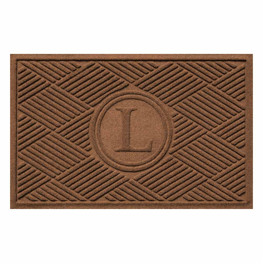 Dark brown rectangular mat with diamond pattern and giant letter