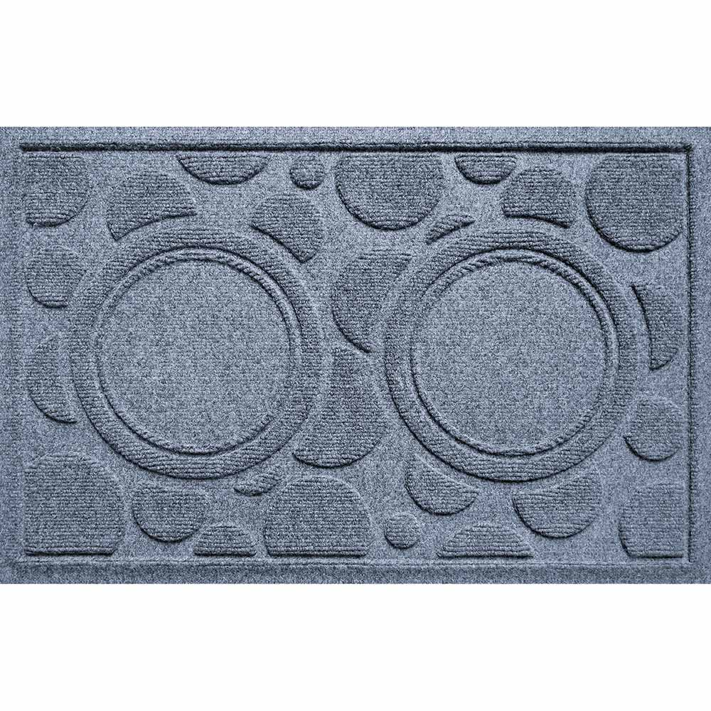 Blue rectangle mat with circle patterns and two big circles on it to place pet food bowls