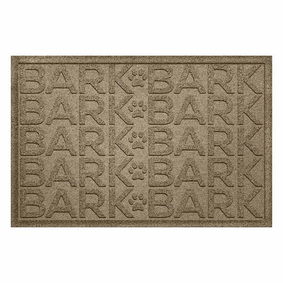 Tan rectangle mat with the word