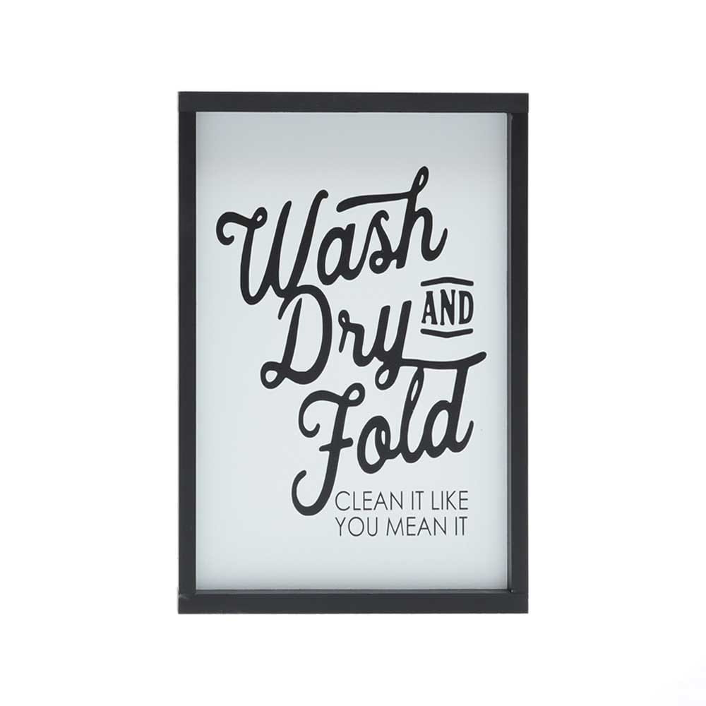 wash, dry, and fold. clean it like you mean it quote stenciled in black on white wood with black wood frame