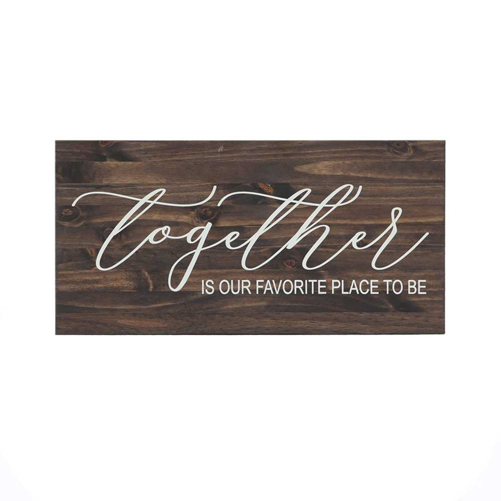 together is our favorite place to be quote stenciled in white on stained wood