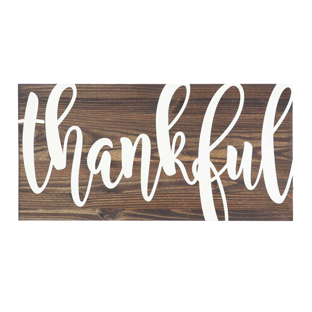 thankful quote stenciled in white on stained wood