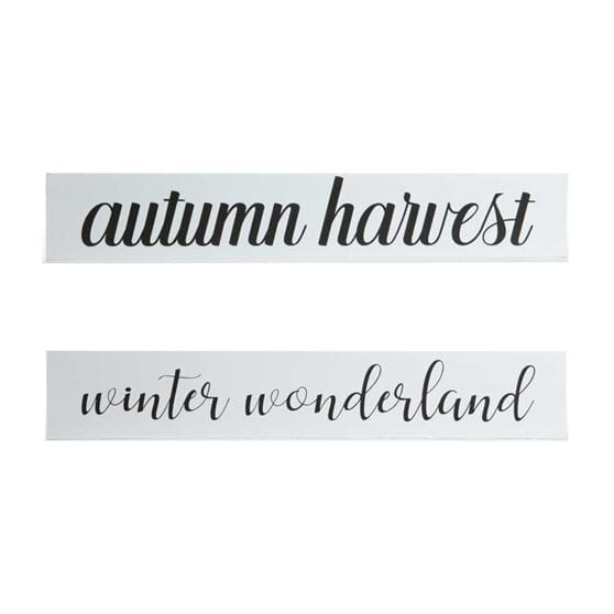 autumn harvest and winter wonderland quote on white wood with black font