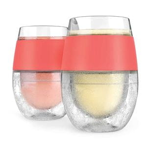 2 staggered stemless FREEZE wine cooling cups with coral bands around tops. One glass has a frozen pink drink, the other glass has a frozen pale yellow drink