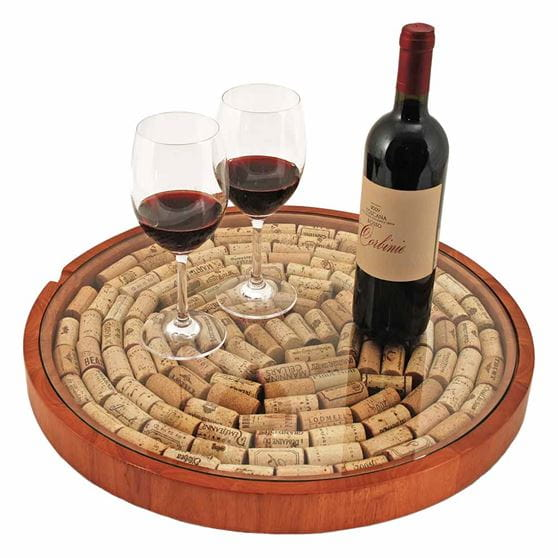 Lazy Susan cork disply with two wine glasses and a wine bottle