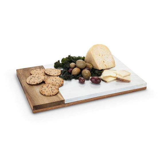 Marble and wood cheese board with food contents and a white background