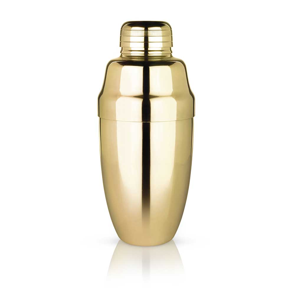 Gold heavyweight cocktail shaker with a white background