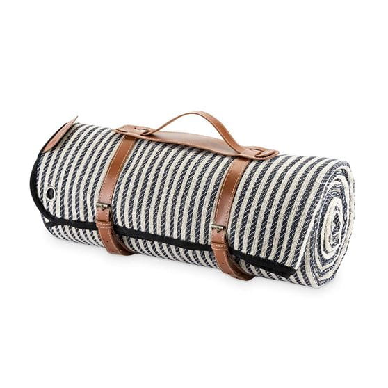 Picnic blanket set side view with the blanket rolled up and a white background