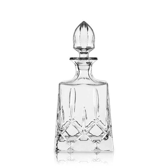 Glass mezcal decanter with a white background