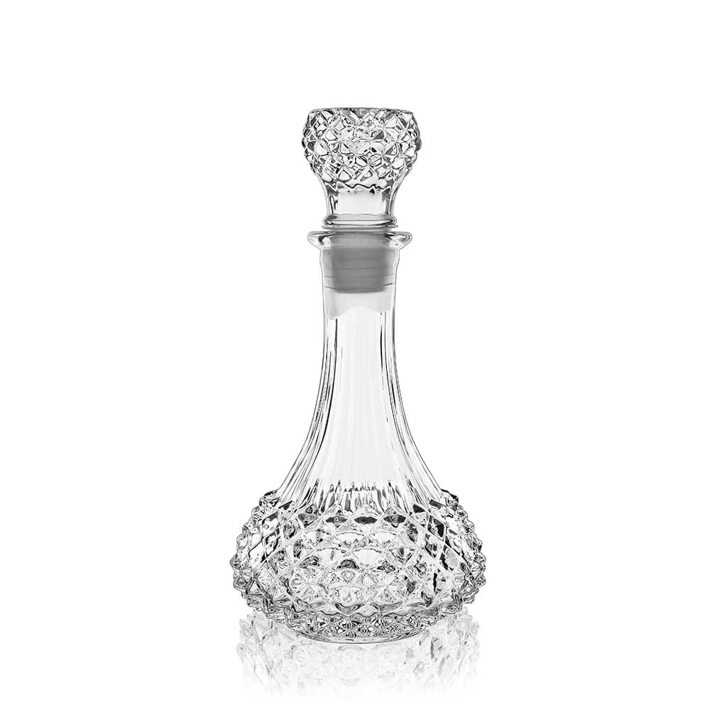 Studded glass decanter with a white background